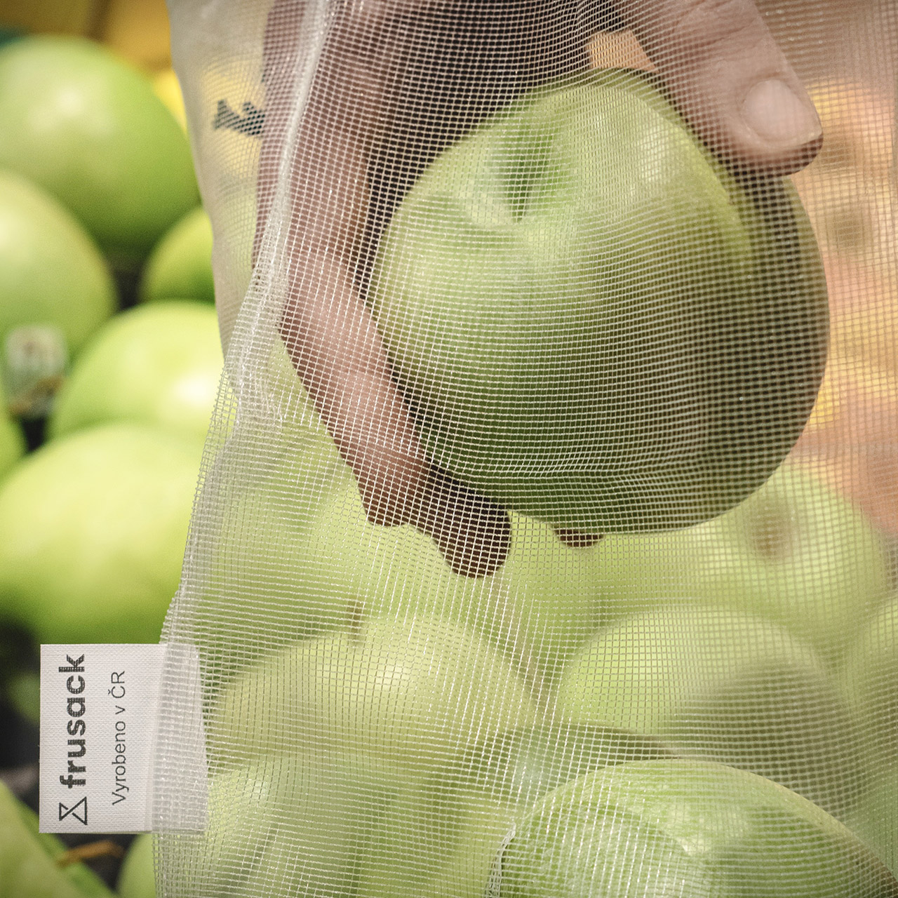 Frusack with apples in supermarket